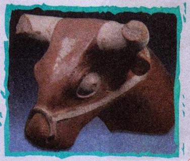 Tunçtan veya bakırdan yapılmış boğa başı